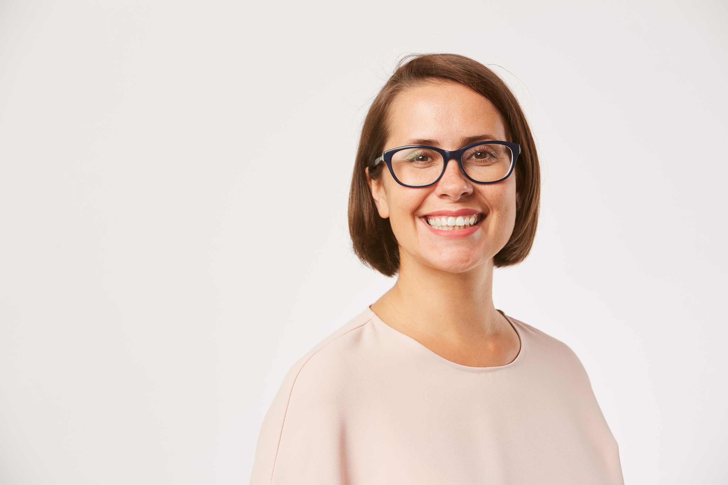Young smiling woman in eyeglasses
